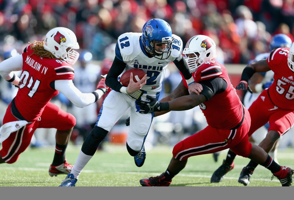 LOUISVILLE, KY - NOVEMBER 23: Lorenzo Mauldin #94 of the Louisville Cardinals sacks Paxton Lynch #12 of the Memphis Tigers during the game at Papa John's Cardinal Stadium on November 23, 2013 in Louisville, Kentucky. (Photo by Andy Lyons/Getty Images)