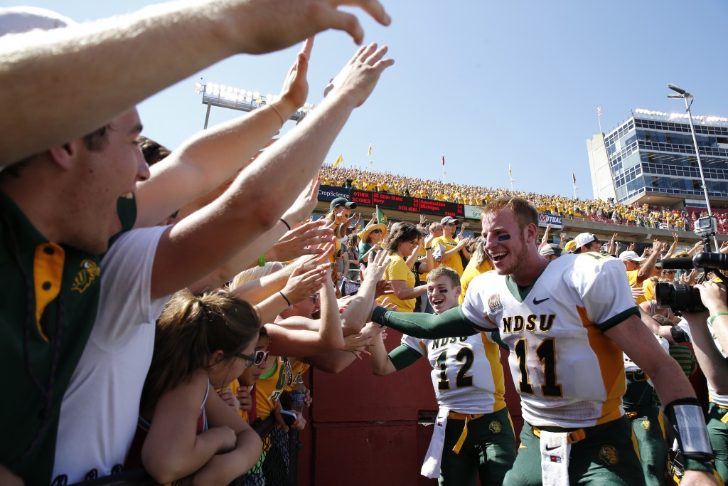 AMES, IA - AUGUST 30: Quarterbacks Carson Wentz #11 and quarterback Easton Stick #12 of the North Dakota State Bison celebrate with fans after defeating the Iowa State Cyclones 34-14 at Jack Trice Stadium on August 30, 2014 in Ames, Iowa. North Dakota State defeated Iowa State 34-14. (Photo by David Purdy/Getty Images)