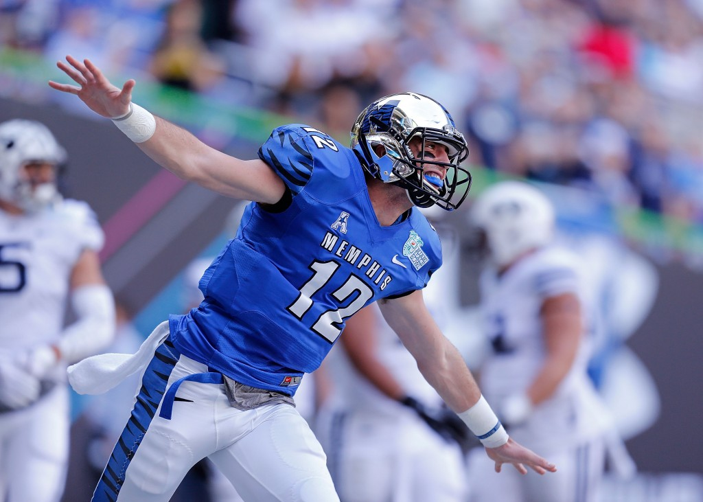MIAMI, FL - DECEMBER 22: Paxton Lynch #12 of the Memphis Tigers reacts after throwing a touchdown pass during the first quarter of the game against the Brigham Young Cougars at Marlins Park on December 22, 2014 in Miami, Florida. (Photo by Rob Foldy/Getty Images)