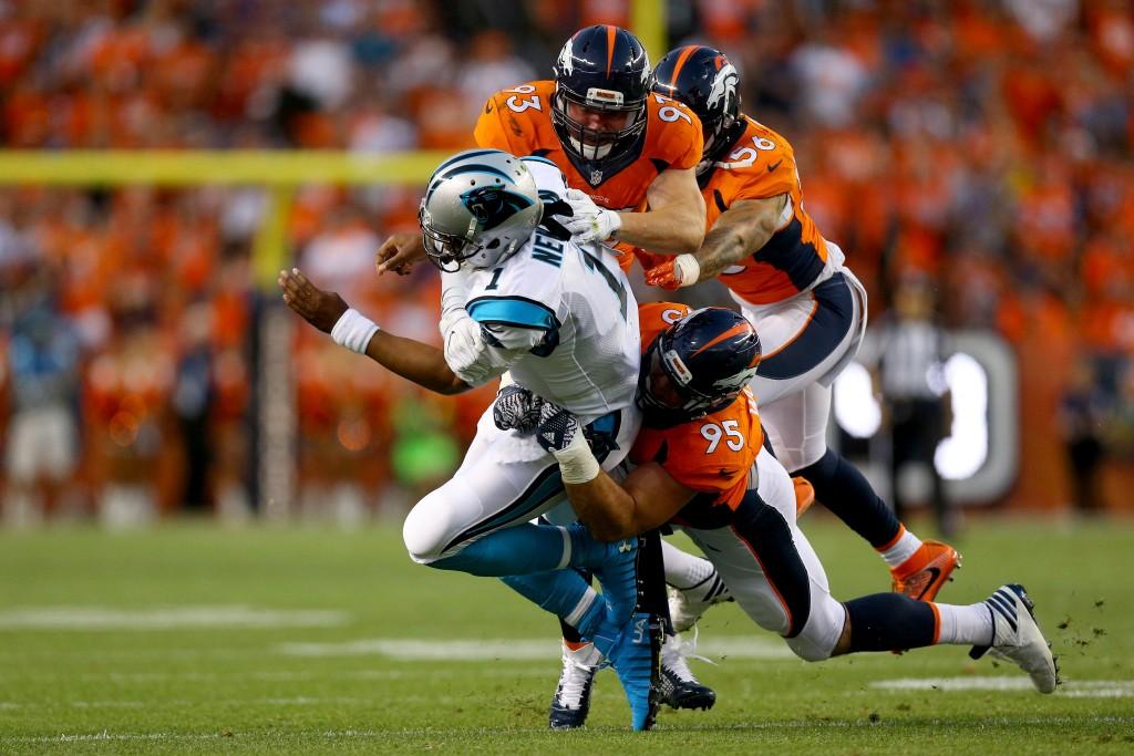 Cam Newton tackled by Denver Broncos